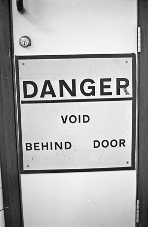 Danger: Void Beind Door Sign